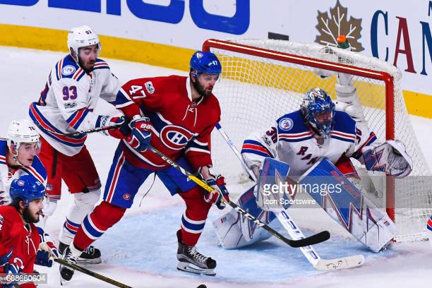 Montreal Canadiens right wing Alexander Radulov sdanding in front of New York Rangers goalie Henrik Lundqvist waiting for the pass for the winning...