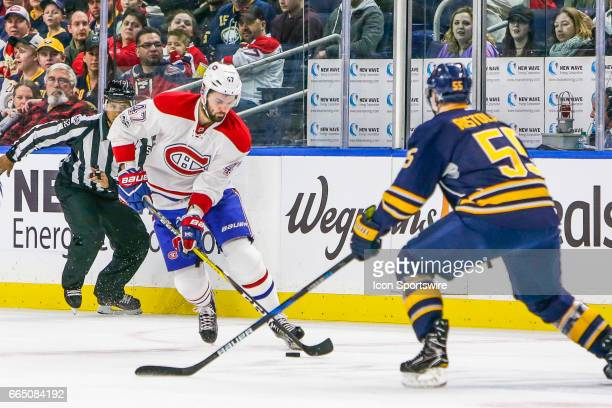Montreal Canadiens Right Wing Alexander Radulov skates with the puck as Buffalo Sabres Defenseman Rasmus Ristolainen defends during the Montreal...
