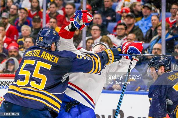 Montreal Canadiens Right Wing Brendan Gallagher falls backwards after being cross checked by Buffalo Sabres Defenseman Rasmus Ristolainen during the...