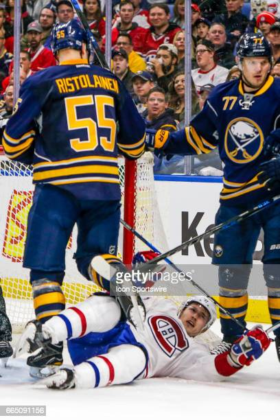 Montreal Canadiens Right Wing Brendan Gallagher falls to the ice as Sabres players skate away after being cross checked by Buffalo Sabres Defenseman...