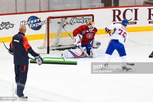 Montreal Canadiens Rookie center Joni Ikonen taking shots on Montreal Canadiens Rookie goalie Michael McNiven during an exercise during the Montreal...