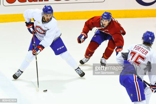 Montreal Canadiens Rookie left wing Jordan Boucher trying to keep the puck in the offensive zone before Montreal Canadiens Rookie right wing William...