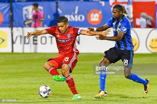 Montreal Impact defender Chris Duvall trying to reach and stop FC Dallas midfielder Victor Ulloa during the FC Dallas versus the Montreal Impact game...