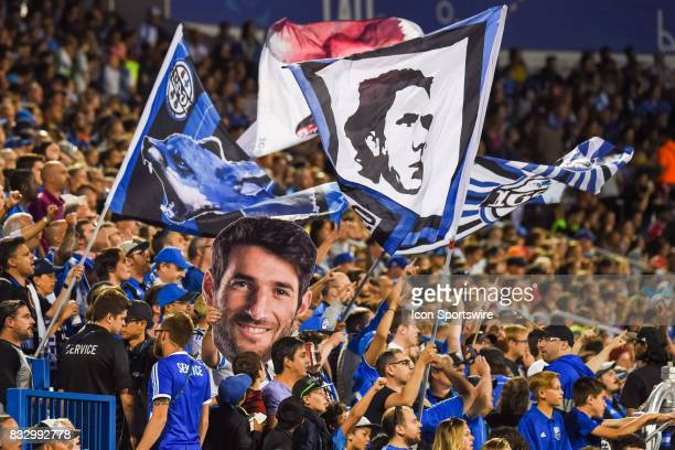 Montreal Impact fans cheering with a cut out face of Montreal Impact midfielder Ignacio Piatti during the Chicago Fire versus the Montreal Impact...