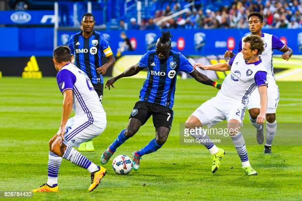 Montreal Impact forward Dominic Oduro battling with many Orlando City SC players to keep control of the ball during the Orlando City SC versus the...