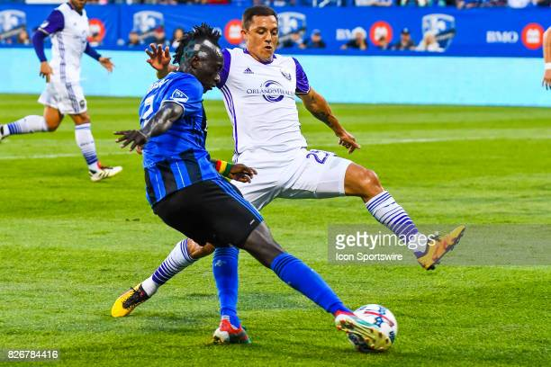 Montreal Impact forward Dominic Oduro kicking the ball while Orlando City SC defender Donny Toia tries to block him during the Orlando City SC versus...