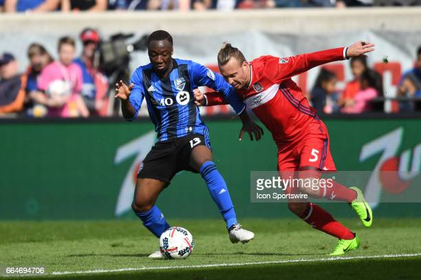 Montreal Impact midfielder Ballou Tabla battles Chicago Fire defender Michael Harrington for the ball during a game between the Montreal Impact and...