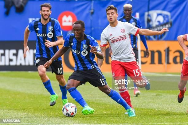 Montreal Impact midfielder Ballou Tabla gaining control of the ball in front of Atlanta United forward Hector Villalba during the Atlanta United FC...