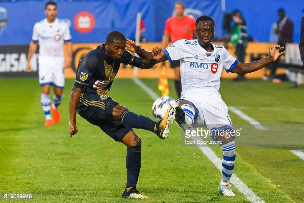 Montreal Impact midfielder Ballou Tabla kicking the ball in the air while a Philadelphia Union player tries to do the same thing during the...