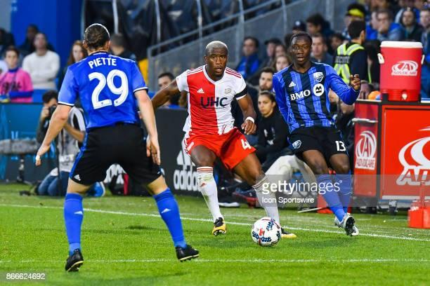Montreal Impact midfielder Ballou Tabla passes the ball to Montreal Impact midfielder Samuel Piette during the New England Revolution versus the...