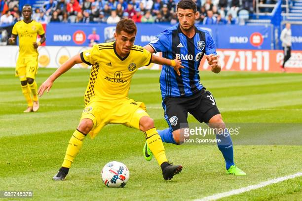 Montreal Impact midfielder Belrim Dzemaili and Columbus Crew midfielder Hector Jimenez battling for control of the ball close to the line during the...