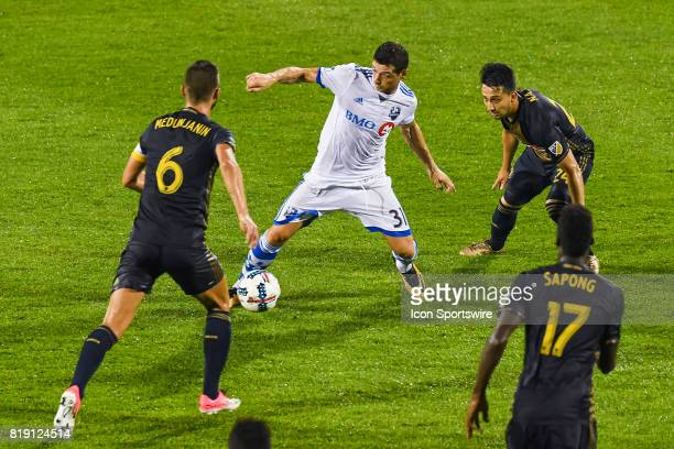 Montreal Impact midfielder Belrim Dzemaili reaching for the ball while surrounded by Philadelphia Union midfielder Haris Medunjanin and Philadelphia...