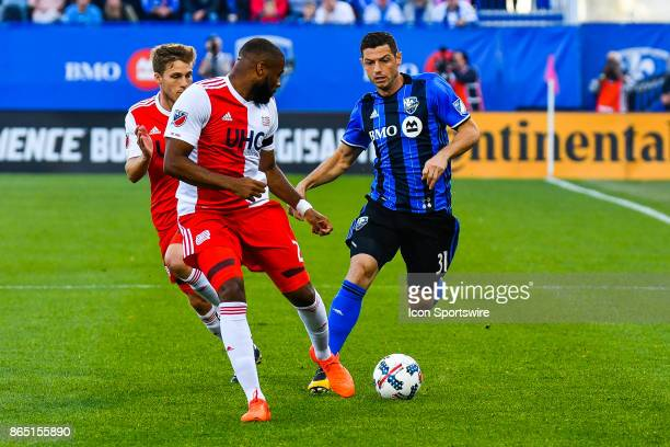 Montreal Impact midfielder Blerim Dzemaili chases the ball with New England Revolution defensive players around him during the New England Revolution...