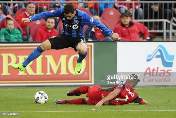 TORONTO ON OCTOBER 15 Montreal Impact midfielder Blerim Dzemaili leaps over Toronto FC defender Justin Morrow as Toronto FC play the Montreal Impact...