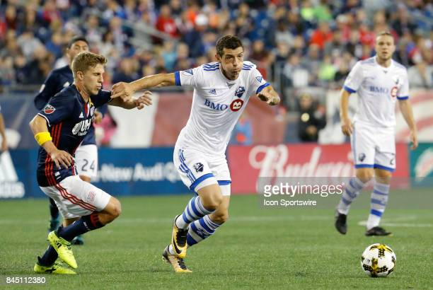Montreal Impact midfielder Blerim Dzemaili moves away from New England Revolution midfielder Scott Caldwell during an MLS match between the New...