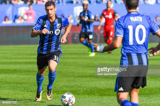 Montreal Impact midfielder Blerim Dzemaili passing the ball to Montreal Impact midfielder Ignacio Piatti during the Toronto FC versus the Montreal...