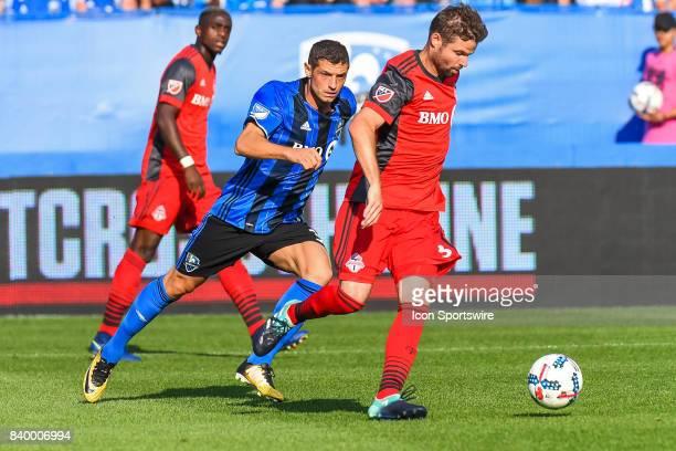 Montreal Impact midfielder Blerim Dzemaili running after Toronto FC defender Drew Moor during the Toronto FC versus the Montreal Impact game on...