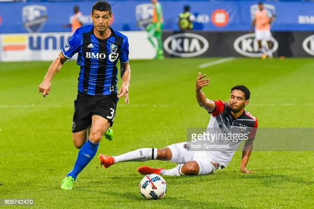 Montreal Impact midfielder Blerim Dzemaili running away with the ball after a collision with DC United midfielder Lamar Neagle who's left on the...