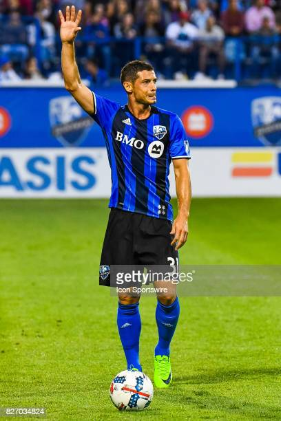 Montreal Impact midfielder Blerim Dzemaili standing up on the field with his arm in the air during the Orlando City SC versus the Montreal Impact...
