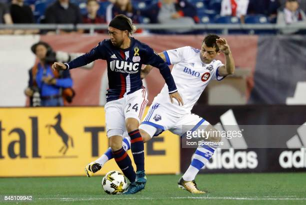 Montreal Impact midfielder Blerim Dzemaili tries to syop New England Revolution midfielder Lee Nguyen during an MLS match between the New England...