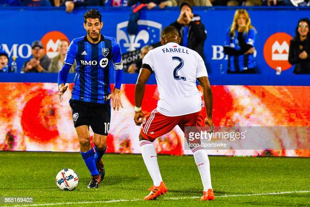 Montreal Impact midfielder Ignacio Piatti thinks about his options to go around New England Revolution defender Benjamin Angoua during the New...