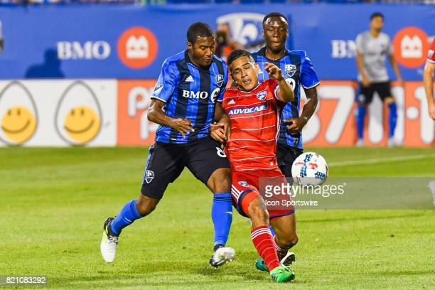 Montreal Impact midfielder Patrice Bernier and FC Dallas midfielder Victor Ulloa colliding while running after the ball during the FC Dallas versus...