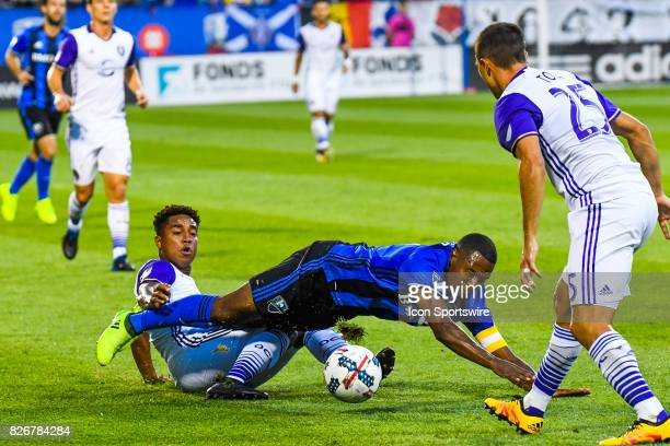 Montreal Impact midfielder Patrice Bernier falling on the ground after Orlando City SC midfielder Cristian Higuita tackles him during the Orlando...