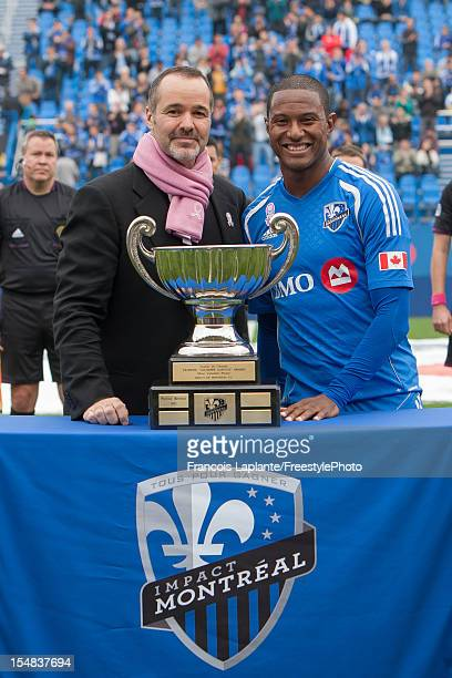Montreal Impact Patrice Bernier poses for a photo along Joey Saputo owner of the Montreal Impact as he receives the most valuable player of the year...