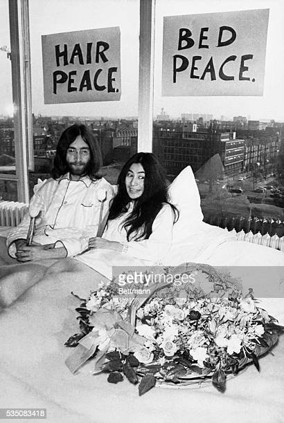 John Lennon and his wife Yoko Ono relax in their hotel suite in Toronto in this May 26 1969 file photo The Lennons have been going around the world...