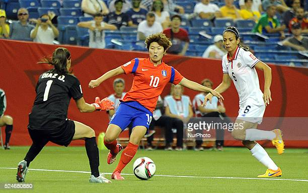 Montreal June 13 2015 Ji Soyun of Korea Republic heads the ball with Dinnia Diaz and CAROL SANCHEZ of Costa Rica during their group E at the 2015...