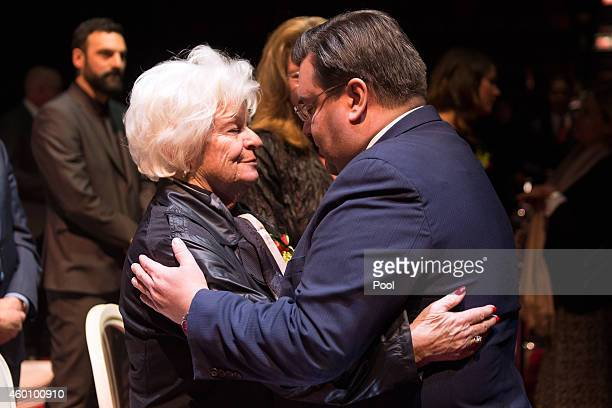 Montreal Mayor Denis Coderre embraces the wife of former Montreal Canadiens player Jean Beliveau Elise during the public viewing at the Bell Centre...