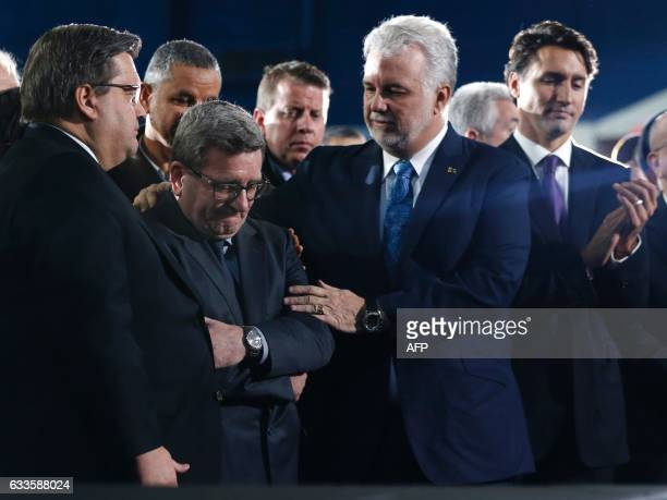 Montreal mayor Denis Coderre looks on as Quebec City mayor Regis Labeaume is comforted by Quebec Premier Philippe Couillard and Canada's Prime...