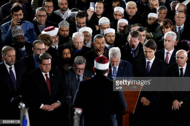 Montreal mayor Denis Coderre Quebec City mayor Regis Labeaume Quebec Premier Philippe Couillard and Canada's Prime Minister Justin Trudeau listen to...