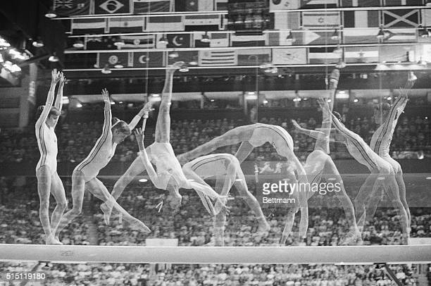 Multiple exposure show's Romania's Nadia Comaneci on the balance beam in Olympic women gymnastics 7/22 as she went on to win her second gold medal of...