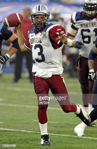 Montreal QB Anthony Calvillo scrambles out of the pocket to pass as the Montreal Alouettes play the Toronto Argonauts in CFL Football action at...