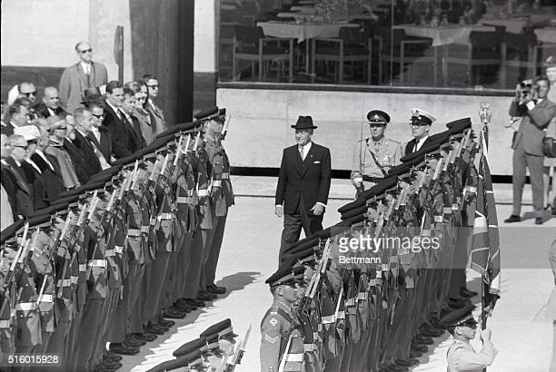 Canada's newly appointed Governor General Roland Michener inspects the Guard of Honor during inauguration ceremonies in 'Places des Nations' 4/27...
