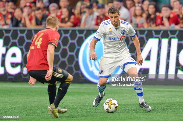 Montreal's Blerim Dzemaili attempts to move around Atlanta's Julian Gressel during the match between Atlanta United and the Montreal Impact on...