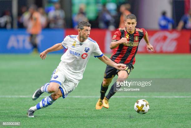 Montreal's Blerim Dzemaili moves by Atlanta defender Carlos Carmona during the match between Atlanta United and the Montreal Impact on September 24...