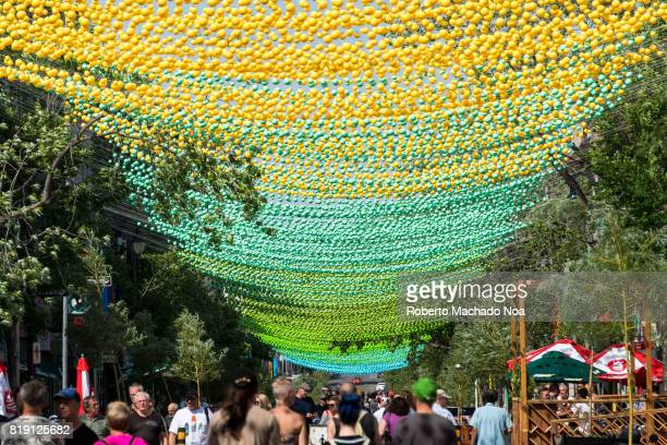 Montreal's gay village iconic colourful balls are a design of architect Claude Cormier This year the work got a rainbow aspect a change from the...
