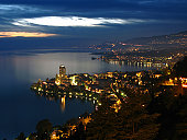 View of the Swiss Riviera from the heights of Montreux (Glion) spreading along the rough coast of Lake Geneva which reflects the beautiful colors of the sunset and of the cities themselves. Montreux w