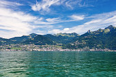 The city of Montreux on the Swiss Riviera seen from a boat on Lake Geneva on a lovely summer day.