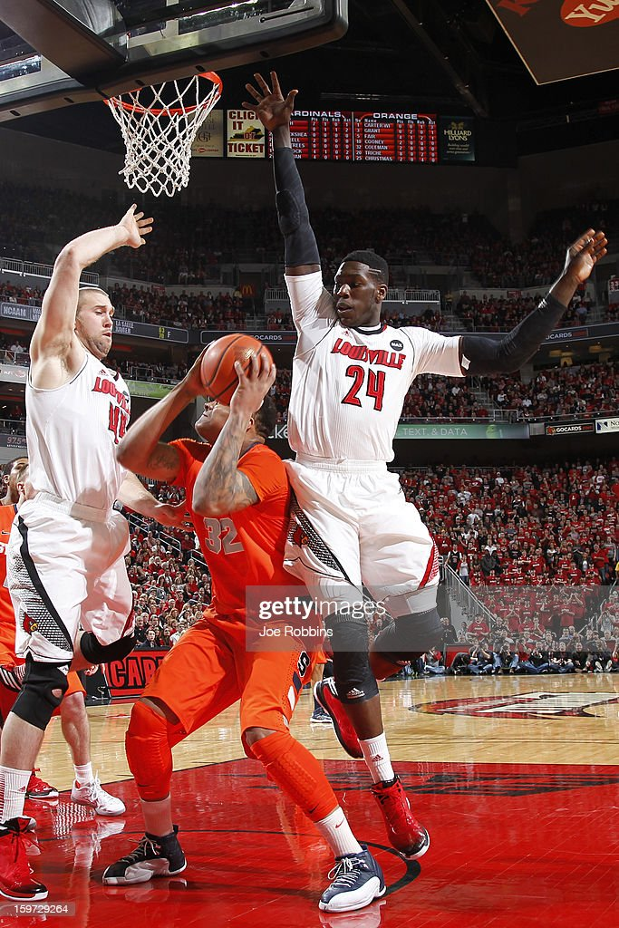 Montrezl Harrell #24 and Stephan Van Treese #44 of the Louisville Cardinals defend against DaJuan Coleman #32 of the Syracuse Orange during the game at KFC Yum! Center on January 19, 2013 in Louisville, Kentucky.