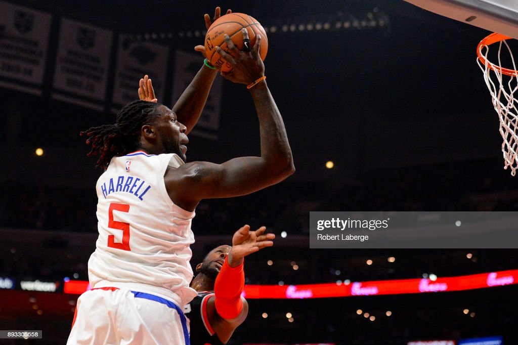 Montrezl Harrell #5 of the Los Angeles Clippers attempts a lay up as C. J. Miles #0 of the Toronto Raptors on December 11, 2017 at STAPLES Center in Los Angeles, California.