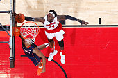 Montrezl Harrell of the Louisville Cardinals blocks a shot against Darion Atkins of the Virginia Cavaliers during the game at KFC Yum Center on March...