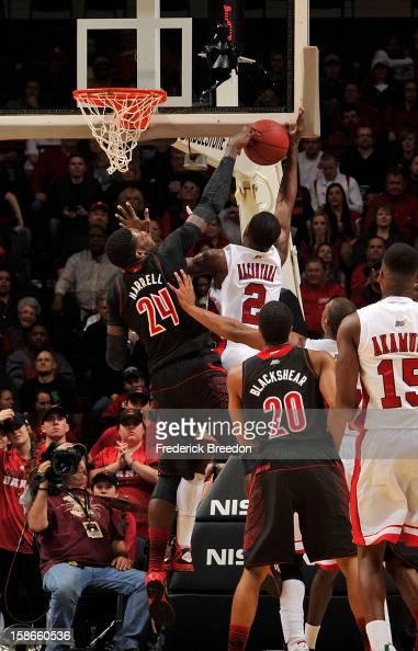 Montrezl Harrell of the Louisville Cardinals blocks the shot of Eddie Alcantara of the Western Kentucky Hilltoppers at Bridgestone Arena on December...