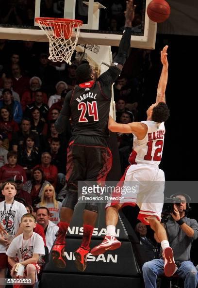Montrezl Harrell of the Louisville Cardinals blocks the shot of Brandon Harris of the Western Kentucky Hilltoppers at Bridgestone Arena on December...
