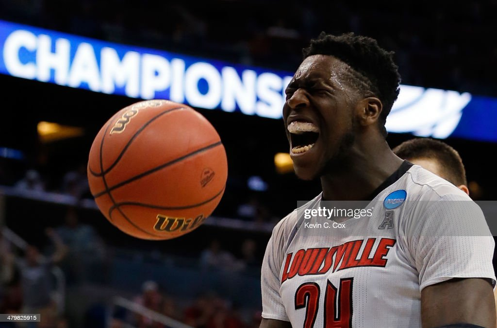 <a gi-track='captionPersonalityLinkClicked' href=/galleries/search?phrase=Montrezl+Harrell&family=editorial&specificpeople=9959702 ng-click='$event.stopPropagation()'>Montrezl Harrell</a> #24 of the Louisville Cardinals celebrates after a basket and the foul in the first half against the Manhattan Jaspers during the second round of the 2014 NCAA Men's Basketball Tournament at Amway Center on March 20, 2014 in Orlando, Florida.
