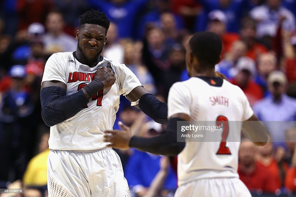 <a gi-track='captionPersonalityLinkClicked' href=/galleries/search?phrase=Montrezl+Harrell&family=editorial&specificpeople=9959702 ng-click='$event.stopPropagation()'>Montrezl Harrell</a> #24 of the Louisville Cardinals celebrates with teammate Russ Smith #2 after a basket against the Kentucky Wildcats during the regional semifinal of the 2014 NCAA Men's Basketball Tournament at Lucas Oil Stadium on March 28, 2014 in Indianapolis, Indiana.
