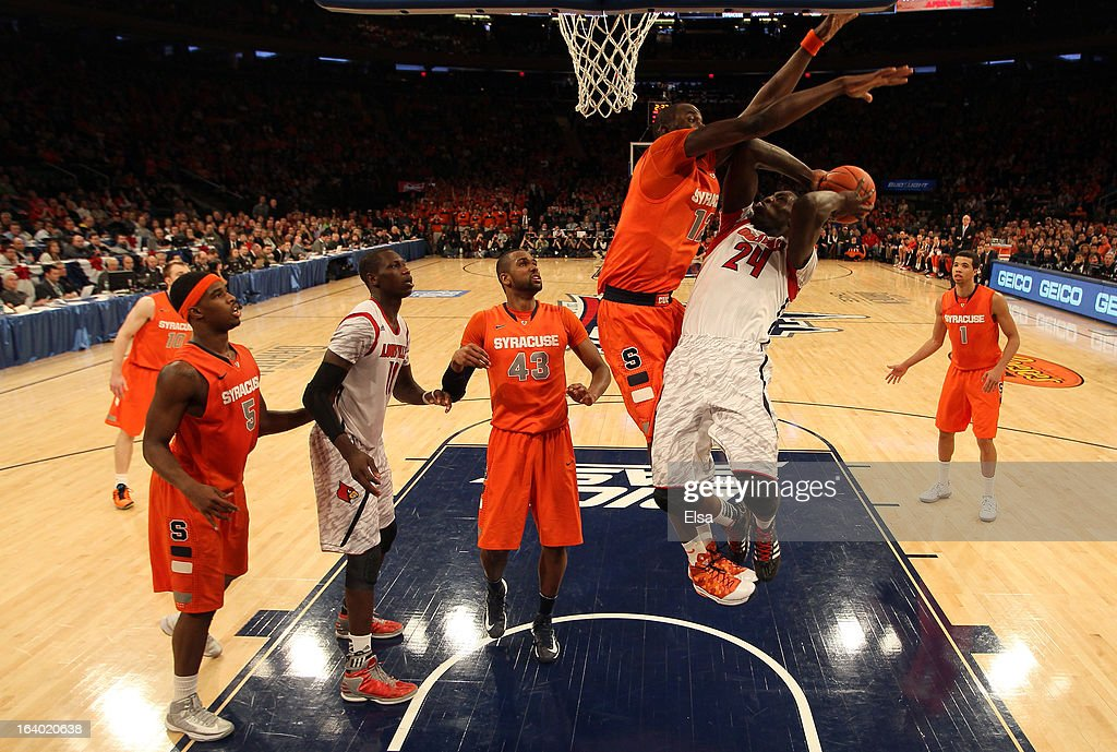 Montrezl Harrell #24 of the Louisville Cardinals drives for a shot attempt against Baye Keita #12 of the Syracuse Orange during the final of the Big East Men's Basketball Tournament at Madison Square Garden on March 16, 2013 in New York City.