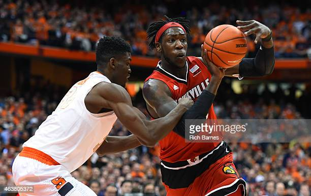 Montrezl Harrell of the Louisville Cardinals drives to the basket against the defense of Chinonso Obokoh of the Syracuse Orange during the first half...